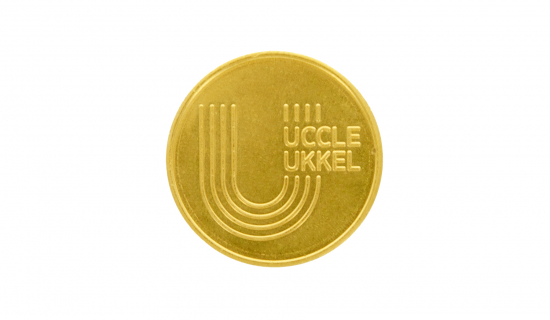 Metal Token in brass with engraving